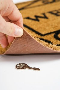 Common mistakes when hiding house keys - welcome mat - King Locksmiths